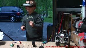 My son wearing Foxtech Video Goggles