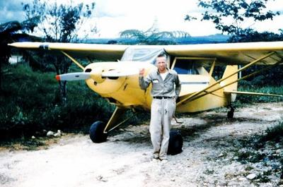 Missionary pilot Nate Saint with the original plane circa 1956